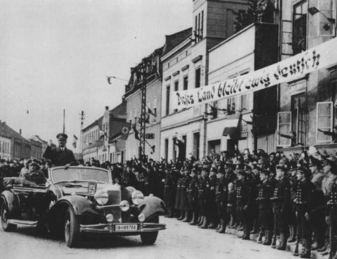 "<p>Hitler enters Memel following the German annexation of Memel from Lithuania. The banner states that ""This land will remain forever German."" Memel, March 1939.</p>"