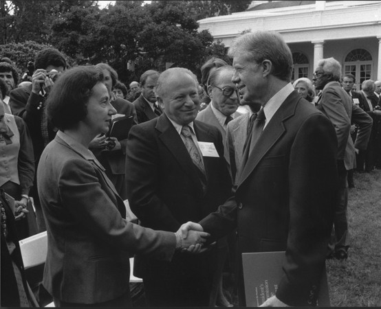 """<p>Vladka and Benjamin Meed (center) with President Jimmy Carter at a White House Rose Garden ceremony marking the official presentation of the report of the US Holocaust Commission to the president by commission chairman <a href=""""/narrative/10130"""">Elie Wiesel</a>. Washington, DC, September 27, 1979.</p>"""