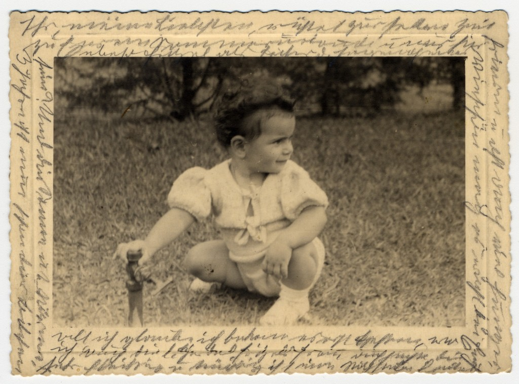 Photograph showing Margarida, Helen Reik's granddaughter, playing on a field in Teresopolis, Brazil, in April 1940.