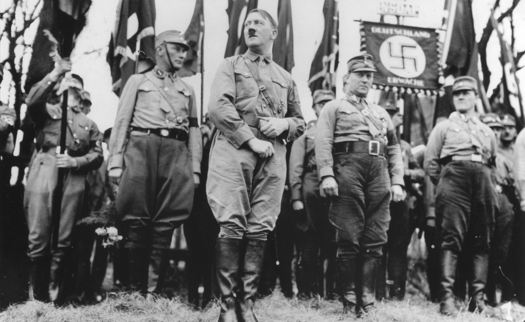 <p>Adolf Hitler stands with an SA unit during a Nazi parade in Weimar, where the constitution of the Weimar Republic was drafted in 1919. Weimar, Germany, 1931.</p>