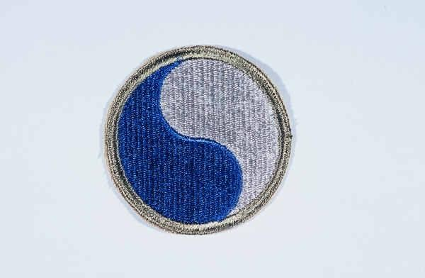 """Insignia of the 29th Infantry Division. """"Blue and Gray"""" was coined as the nickname of the 29th Infantry Division by the division's ... [LCID: n05635]"""