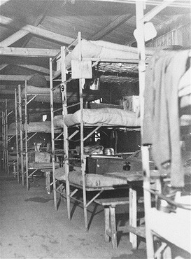 The interior of a barracks at the Westerbork transit camp, after liberation. [LCID: 41174]