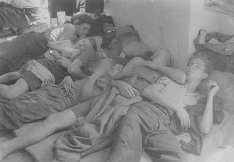 Jewish refugees, part of the Brihah movement (the postwar mass flight of Jews from eastern Europe), sleep on a crowded floor on the ... [LCID: 80973]