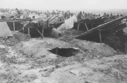 Dugouts, which served as living quarters for prisoners in Stalag 319—a Nazi-built camp for Soviet prisoners of war. [LCID: 80789]