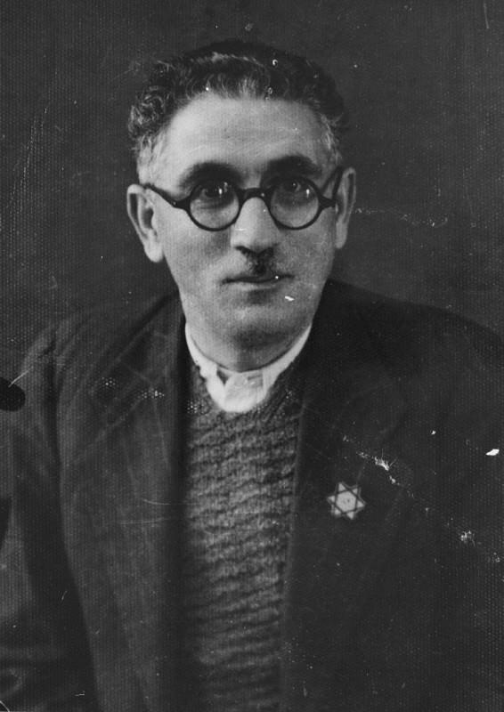 Joseph Levi, a pharmacist and the head of the Jewish community of Komotine, wearing the compulsory Jewish badge. [LCID: 79805]