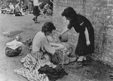 <p>Soon after liberation, concentration camp survivors wash each other with some of the site's limited supply of water. Bergen-Belsen, Germany, April 21, 1945.</p>