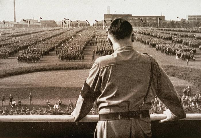 "<p><a href=""/narrative/43"">Adolf Hitler</a> addresses an SA rally. Dortmund, Germany, 1933. </p>"