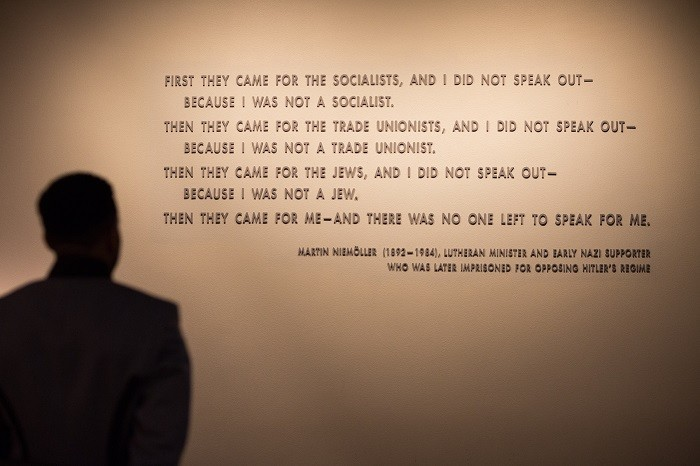 A visitor stands in front of the quotation from Martin Niemöller that is on display in the Permanent Exhibition of the United States ... [LCID: usma0093]