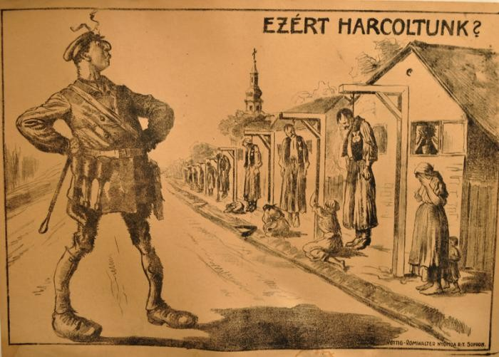 "1919 anti-Jewish propaganda poster of a Jewish Communist soldier gloating at hanged war heroes, titled ""Is this why we fought?"""