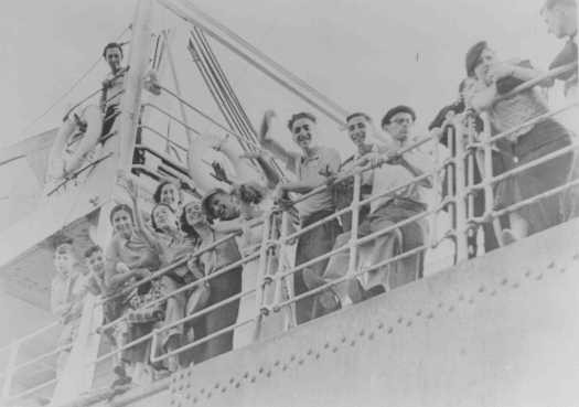 "Jewish refugee youth sail for Palestine from an Italian port on the Aliyah Bet (""illegal"" immigration) ship ""Parita."" [LCID: 86614]"