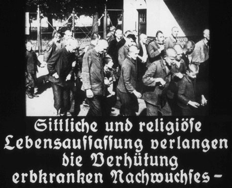 "<p>This image originates from a film produced by the <a href=""/narrative/11806"">Reich Propaganda Ministry</a>. It is captioned: ""A moral and religious conception of life demands the prevention of hereditarily ill offspring."" Nazi propaganda aimed to create public support for the compulsory sterilization effort.</p>"