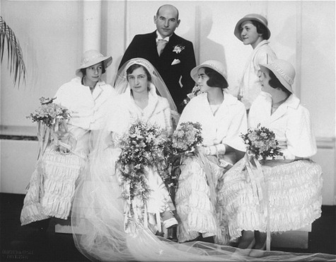 Portrait of Hilde and Gerrit Verdoner, with four bridesmaids, on their wedding day. [LCID: 02769]