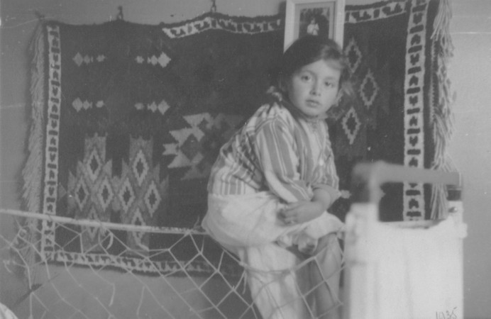 "<p>Portrait of a young Jewish girl, Lida Kleinman sitting in her room in Lacko, Poland, 1935. In January 1942, Lida was sent into hiding. She <a href=""/narrative/7723"">hid under false identities</a> in Catholic orphanages until the end of the war.</p>"