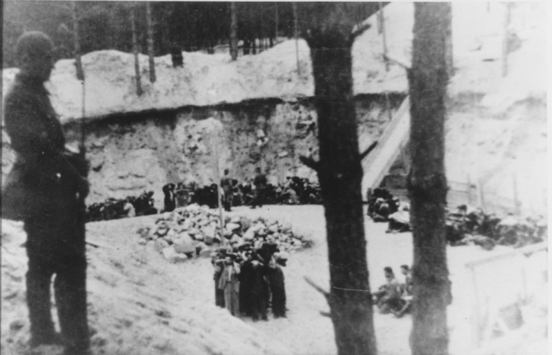 "<p>Lithuanian <a href=""/narrative/6437"">collaborators</a> guard Jews before their execution. Ponary, <a href=""/narrative/5762"">Lithuania</a>, June–July, 1941.</p>"