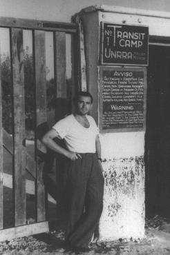 "A gate at the displaced persons camp in Bari. The warning states that non-residents of the camp ""will be handed over to the Italian authorities for punishment if they are found in camp without permission from the camp office."""