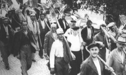 "<p>Jews drafted into the Hungarian Labor Service System march to a work site. Szeged, <a href=""/narrative/6206/en"">Hungary</a>, between 1940 and 1944.</p>"