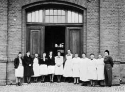 "<p>Some of the nursing staff of the <a href=""/narrative/4032"">""euthanasia""</a> clinic at <a href=""/narrative/8116"">Hadamar</a> stand outside of the institution after the arrival of US forces, April 5, 1945. Irmgard Huber, the head nurse of the clinic, is probably the person standing fifth from the right. © IWM EA 62183</p>"