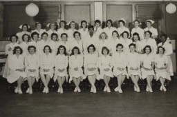 <p>Blanka (middle row, third from right) graduates to become a pediatric nurse. December 1947.</p>