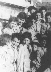"<p>A group of Polish Jewish refugee <a href=""/narrative/2562"">children</a> (known as the ""<a href=""/narrative/11006"">Tehran Children</a>"") arrives in Palestine via <a href=""/narrative/11747"">Iran</a>. Atlit reception camp, Palestine, February 18, 1943.</p>"