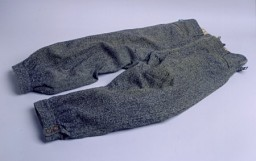 <p>Pants worn by Marjan Glass as he dug anti-tank ditches for the defense of Warsaw, Poland, and then as he hastily fled the city ahead of the German advance on September 7, 1939. Glass, a lawyer, escaped with his wife and three-year-old son, and his wife's mother and brother. He left without taking the time to change from his soiled work clothing. [From the USHMM special exhibition Flight and Rescue.]</p>