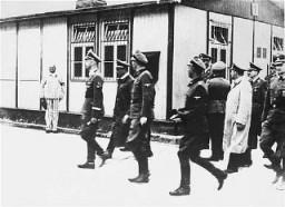 """<p><a href=""""/narrative/10799/en"""">SS</a> chief <a href=""""/narrative/10813/en"""">Heinrich Himmler</a> leads an inspection of the <a href=""""/narrative/3880/en"""">Mauthausen</a> concentration camp. Austria, April 27, 1941.</p>"""