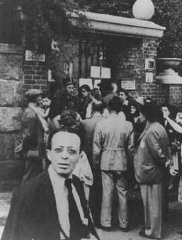 <p>Hungarian Jews wait in front of the Swedish legation main office in hopes of obtaining Swedish protective passes. Budapest, Hungary, 1944.</p>