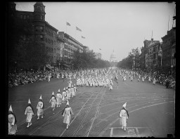 "<div class=""show-data"">The Ku Klux Klan marches down Pennsylvania Ave in Washington, DC. Photograph by Harris & Ewing, 1926.</div>