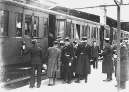 "<p>Jewish deportees, guarded by French police, board a train at the Austerlitz station for transport to the Pithiviers internment camp. <a href=""/narrative/6033/en"">Paris</a>, France, May 1941.</p>"