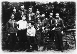 Group portrait of members of the Hashomer Hatzair Zionist youth movement in Kalisz, Poland, 1933.
