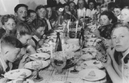 Passover seder for children in the Landsberg displaced persons camp. [LCID: 61090]