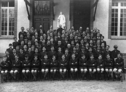 Father Jacques (center, third row) with students of the Petit College Sainte-Therese de l'Enfant Jesus.