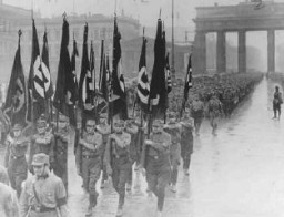 <p>Members of the Storm Troopers (SA) march through the Brandenburg gate. Berlin, Germany, April 8, 1933.</p>