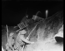 <p>Trench warfare is one of the iconic symbols of World War I. This photograph shows British troops carrying boards over a support line trench at night during fighting on the western front. Cambrai, France, January 12, 1917.</p>