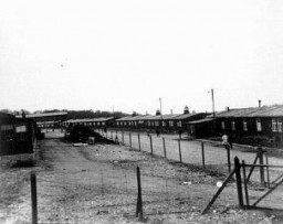 "<p>A view of barracks in the <a href=""/narrative/3956/en"">Buchenwald</a> concentration camp. This photograph was taken after the <a href=""/narrative/2317/en"">liberation</a> of the camp. Buchenwald, Germany, after April 11, 1945.</p>