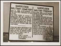 "<p>A sign at the military cemetery in <a href=""/narrative/8101/en"">Gardelegen</a> in memory of the prisoners who were killed by the SS in a barn near the town. Germany, April 18, 1945.</p>"