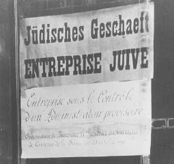 "<p>""<a href=""/narrative/21671/en"">Aryanization</a>"" in France: this shop, belonging to Jews, has been given to a non-Jewish ""temporary administrator."" Paris, April 1942.</p>"