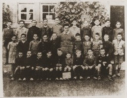 "<p>A class of boys from the school in <a href=""/narrative/11405/en"">Oradour</a>. All of the people pictured here were killed by the SS during the June 10, 1944, massacre. Oradour-sur-Glane, France, photograph taken between 1940 and June 1944.</p>"