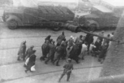 "<p>Jews captured during the <a href=""/narrative/3636"">Warsaw ghetto uprising</a> are marched past the St. Zofia hospital down Nowolipie Street towards the <em>Umschlagplatz</em> for deportation. </p>"