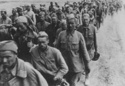 """<p>Columns of Soviet prisoners of war. Soviet Union, September 15, 1942.</p> <p>Second only to the Jews, Soviet prisoners of war were the largest group of victims of<a href=""""https://encyclopedia.ushmm.org/narrative/10962/en"""">Nazi racial policy</a>.</p>"""