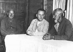 "<p>Social Democratic political prisoners in the Duerrgoy <a href=""/narrative/4656/en"">concentration camp</a> near Breslau. Seated in the center is Paul Loebe, a leading Socialist and former president of the German parliament. Duerrgoy camp, Germany, August 4, 1933.</p>"