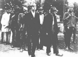 <p>A Serbian gendarme serving the Serbian puppet government led by Milan Nedia escorts a group of Roma (Gypsies) to their execution. Yugoslavia, ca. 1941–1943.</p>