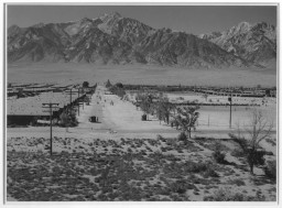 "<p>Manzanar <a href=""/narrative/32232/en"">relocation</a> center for Japanese Americans, photographed by Ansel Adams. Bird's-eye view of the grounds from the guard tower.</p>"
