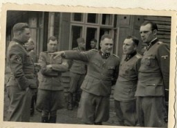 <p>This photograph shows a group of SS officers at Solahuette, the SS retreat outside of Auschwitz. Pictured from left to right: Josef Kramer, Dr. Josef Mengele, Richard Baer, Karl Höcker, and an unidentified officer.</p>