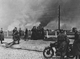 Smoke rises from Warsaw following the German attack