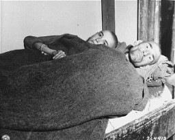 "<p>Two political prisoners, after US soldiers liberated the <a href=""/narrative/7864/en"">Gusen</a> concentration camp. Austria, May 12, 1945.</p>"