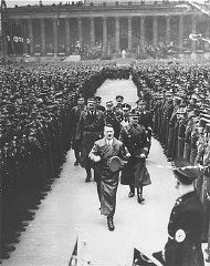 """<p><a href=""""/narrative/35294/en"""">Adolf Hitler</a> reviews SA troops celebrating the third anniversary of his assumption of power. Berlin, Germany, February 20, 1936.</p>"""