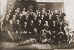 <p>Group portrait of members of the Freemasons Lodge of Chernovtsy, Bukovina, approximately 75 percent of whom were Jewish. The members were mainly intellectuals and leaders in business and local government. Among those pictured are Dr. Max Ennis (top row, third from the left); pharmacist, Dr. Abraham Guttman (top row, far right); an official in the revenue service, Dr. Max Gottfried (second row from the top, sixth from the left); and the judge, Dr. Jacob Rubel (third row from the top, far left). Chernovtsy, Romania, 1920–25.</p>