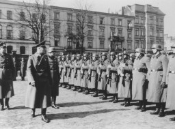 <p>German Order Police officers inspect members of Police Battalion 101 in Lodz after the German occupation of Poland, 1939–1943.</p>