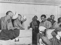"<p>Liberated prisoners at the Ebensee camp. Too weak to eat solid food, they drink a thin soup prepared for them by the US Army. Photograph taken by <a href=""/narrative/8129/en"">US Army Signal Corps</a> photographer <a href=""/narrative/8148/en"">J Malan Heslop</a>. Austria, May 8, 1945.</p>"