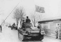 <p>German tanks cross the Czech border, in violation of the 1938 Munich agreement. Pohorelice, Czechoslovakia, March 15, 1939.</p>
